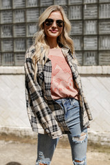 Model wearing the Adventure Vintage Washed Graphic Tee with a flannel