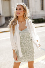 Dress Up model wearing a Ruched Floral Mini Dress with a white linen blouse