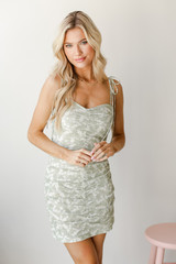 Model wearing a sage Ruched Floral Mini Dress