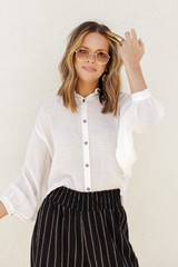 White - Dress Up model wearing a Linen Button Up Top with wide leg pants