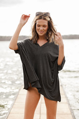 Charcoal - Model wearing an Oversized Tunic over a swimsuit