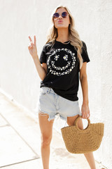 Model wearing a Flower Child Graphic Tee