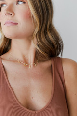 Model wearing a Gold Butterfly Charm Necklace
