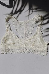 Flat Lay of a Lace Racerback Bralette in Ivory