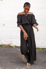 Model wearing Wide Leg Pants in Black with the matching crop top