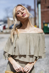 Olive - Dress Up model wearing a Tiered Ruffle Off The Shoulder Top