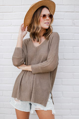 Mocha - Dress Up model wearing the Feel The Breeze Knit with a straw hat