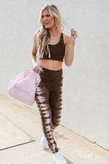 Model wearing High-Waisted Tie-Dye Leggings with the matching sports bra
