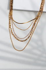 Flat Lay of a Gold Rhinestone Chain Layered Necklace
