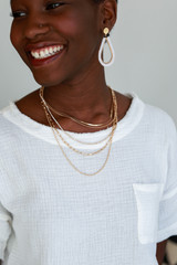 Model wearing a Gold Rhinestone Chain Layered Necklace with earrings