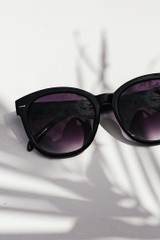 Flat Lay of Square Sunglasses in Black