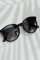Flat Lay of Round Sunglasses in Black