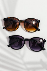 Flat Lay of both colors of Round Sunglasses