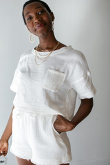 White - Dress Up model wearing Linen Shorts with the matching top
