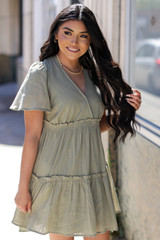Model wearing a Tired Babydoll Dress in Olive