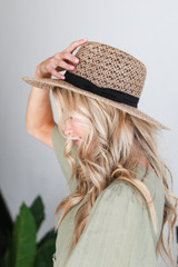 Model wearing a Straw Fedora Hat in Taupe