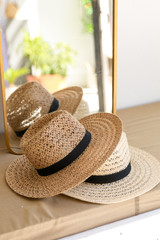 Flat Lay of both of the Straw Fedora Hats