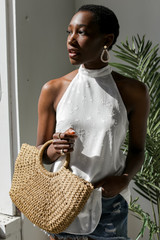Ivory - Model wearing a Sleeveless Top
