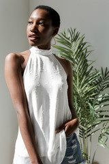 Model wearing a Sleeveless Top in Ivory