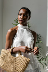Dress Up model wearing a Sleeveless Top in Ivory