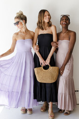Models wearing a Strapless Smocked Maxi Dress