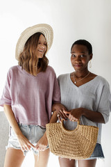Models wearing a linen Relaxed Fit Top