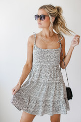White - Model wearing a Spotted Tiered Dress with sunglasses