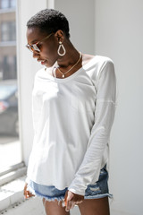 White - Dress Up model wearing a Long Sleeve Pocket Tee