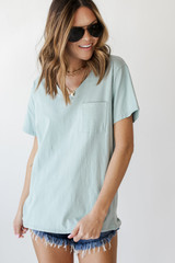Mint - Model wearing an Everyday Pocket Tee with denim shorts