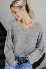 Model wearing a Knit Top with denim shorts