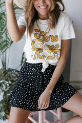 Model wearing the Here Comes the Sun Vintage Graphic Tee with a mini skirt