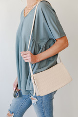 Model carrying a Crocodile Crossbody Bag in Ivory