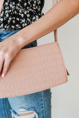Close Up of a Crocodile Crossbody Bag in Pink