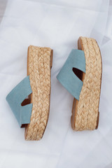 Flat Lay of blue Platform Espadrilles on a white background