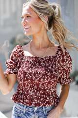 Wine - Model wearing a Smocked Floral Blouse