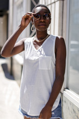 White - Model wearing a Relaxed Fit Pocket Tank
