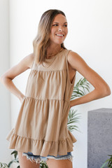 Model wearing a taupe Tiered Ruffle Tank