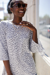 Heather Grey - Model wearing a Leopard Top