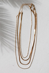 Flat Lay of a Gold Layered Necklace