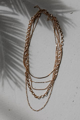 Flat Lay of a Gold Chain Layered Necklace