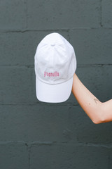 White - Model holding the Greenville Summer Cities Hat