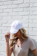 Model wearing the Charleston Summer Cities Hat in White