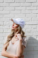 Model wearing the Dahlonega Summer Cities Hat in White