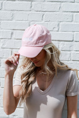 Model wearing the Savannah Summer Cities Hat in Blush