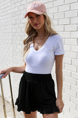 White - Model wearing an Everyday Bodysuit with shorts