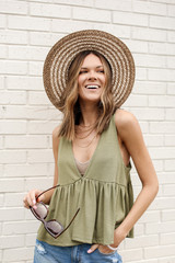 Olive - Model wearing a Summer Breeze Tank with a straw hat