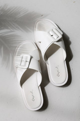 White - Flat Lay of Buckled Slide Sandals