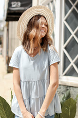 Light Blue - Model wearing a Tiered Babydoll Tee with a straw hat