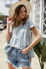 Light Blue - Dress Up model wearing a Tiered Babydoll Tee with a straw hat
