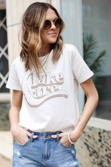 Dress Up model wearing the Take Care Graphic Tee from Dress Up